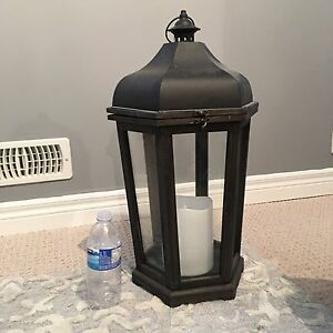 Lantern with battery operated candle with timer