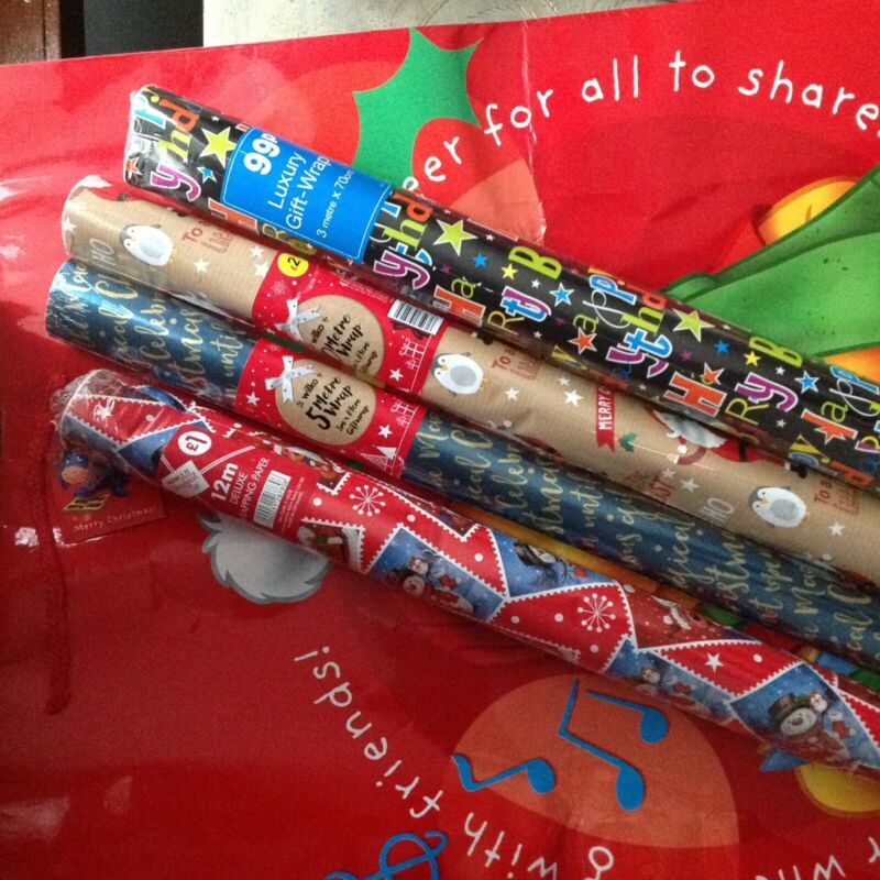 Christmas+wrapping+paper%2C+metallic+bows+and+ribbon+and+a+musical+stocking