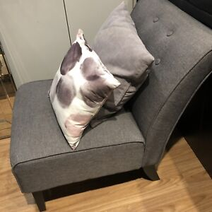 Gray chair with pillows
