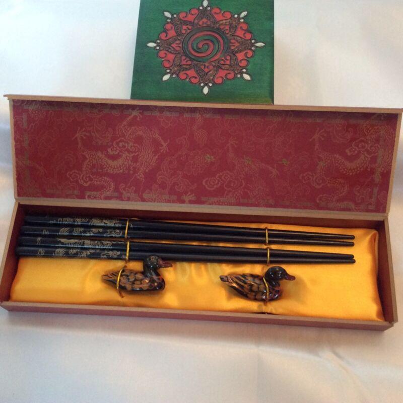 Chinese 4 wooden chopststicks w/ dragon design 2 duck holders /decorative box.
