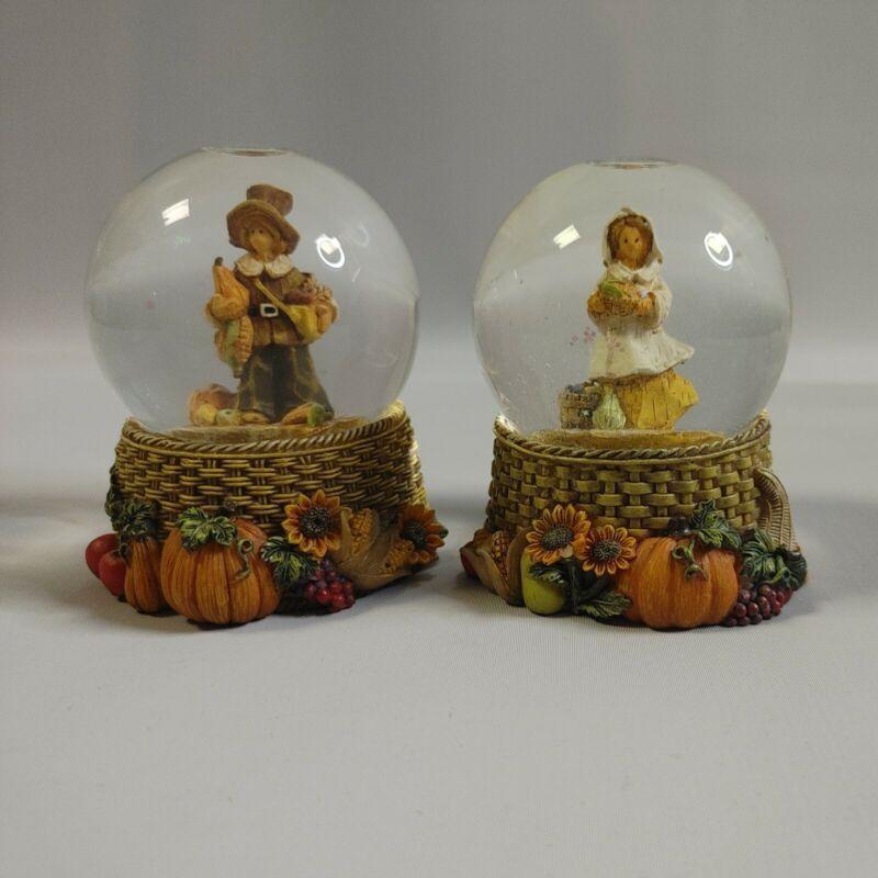 "Pair of Thanksgiving Pilgrim Man & Woman Snow Globes 3 1/2"" Tall"