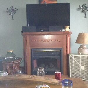 Large fire place with built in bar for sale!!