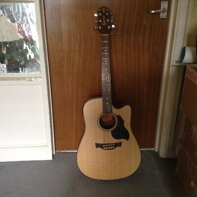 Crafter semi acoustic guitar with case, strings and jack to jack lead.