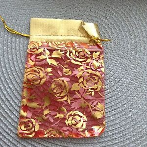 Red golden party favour bags size 5x4