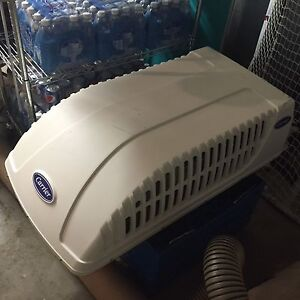 (2) CARRIER ROOFTOP A/C UNITS