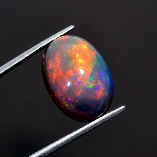 6.5 Ct. Natural Color Play Black Ethiopian Opal Oval Cabochon Loose Gemstone