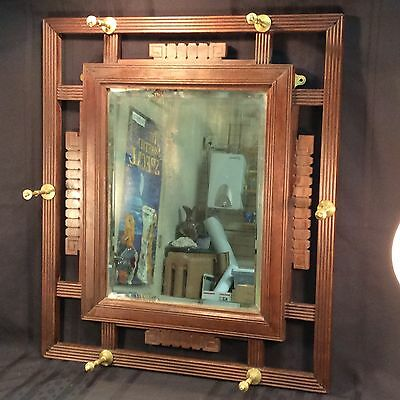 Antique Eastlake beveled hall mirror with brass hat & coat pegs; late 1800's