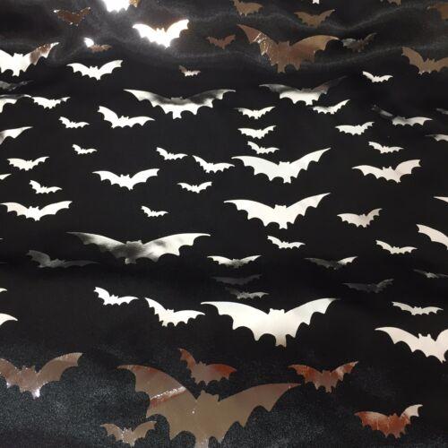 silver foil bats on black satin fabric