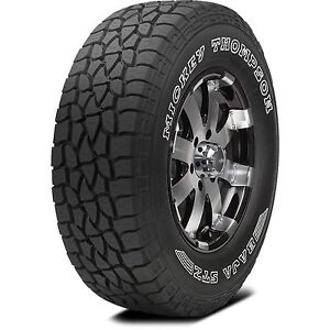 """20"""" Cali Offroad Chrome rims and Mickey Thompson Tires."""