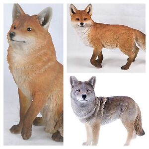 Fox and coyote wildlife animal sculptures