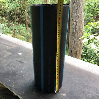 Small length of thick plastic water mains pipe. 180 wide x 20mm thick.