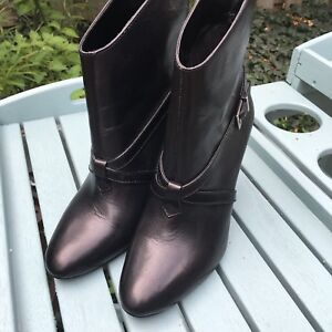 Brand new black ankle boots by BCBG size 8