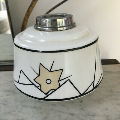 white and geometric design art deco oil lamp font chrome