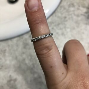 Size 4 White Gold band with 11 stones