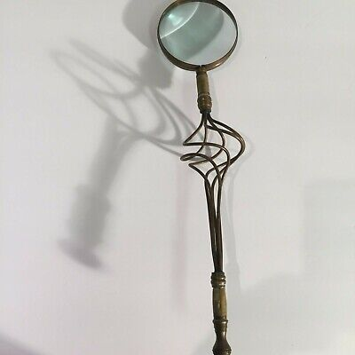 Antique vintage magnifying glass with unique stone handle replica
