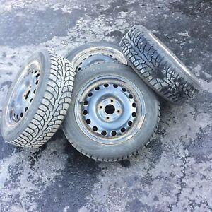 15 inch snow tires on rims.