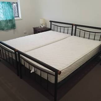 TWO SINGLE BEDS & MATRESSES - METAL FRAME, TIMBER SLATS