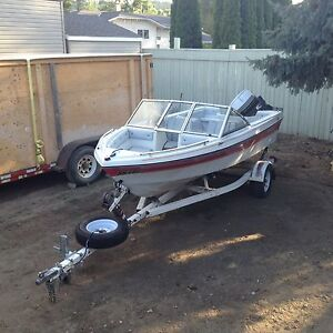1986 16' fibretech open bow with 70 hp evinrude