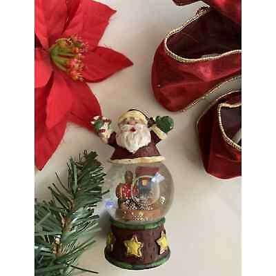 Santa on a Toy Train with Candy Cane Snow Globe