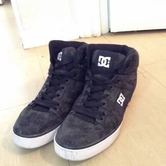 black DC high top skate shoes