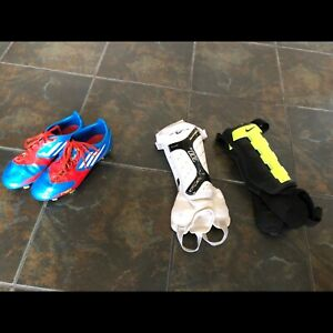 Adidas soccer shoes and shin guards