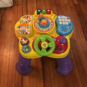 Baby to toddler sit-stand learning table