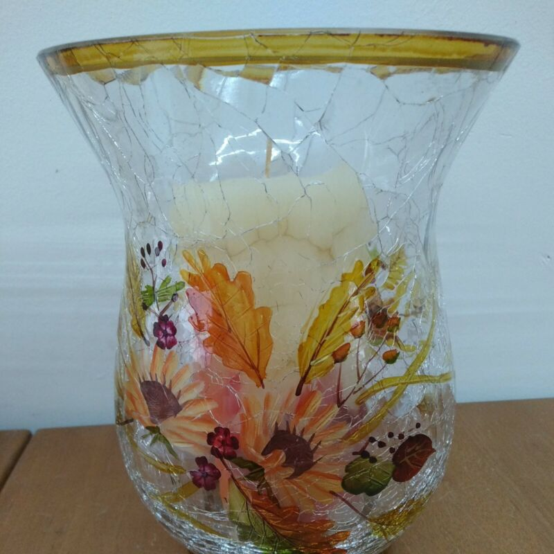 Beautiful Tall Cracked Glass Candle Holder With Sunflowers On It Candle inside.