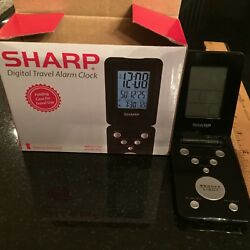 Sharp Digital Travel Alarm Clock, Slim Black with box uses 1 button cell battery