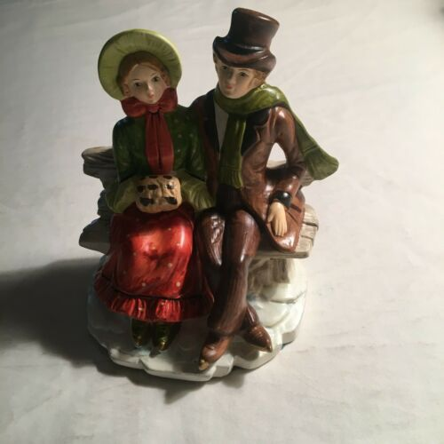 FB  CHRISTMAS MAN AND WOMAN SITTING ON A BENCH CERAMIC SCULPTURE~FIGURINES