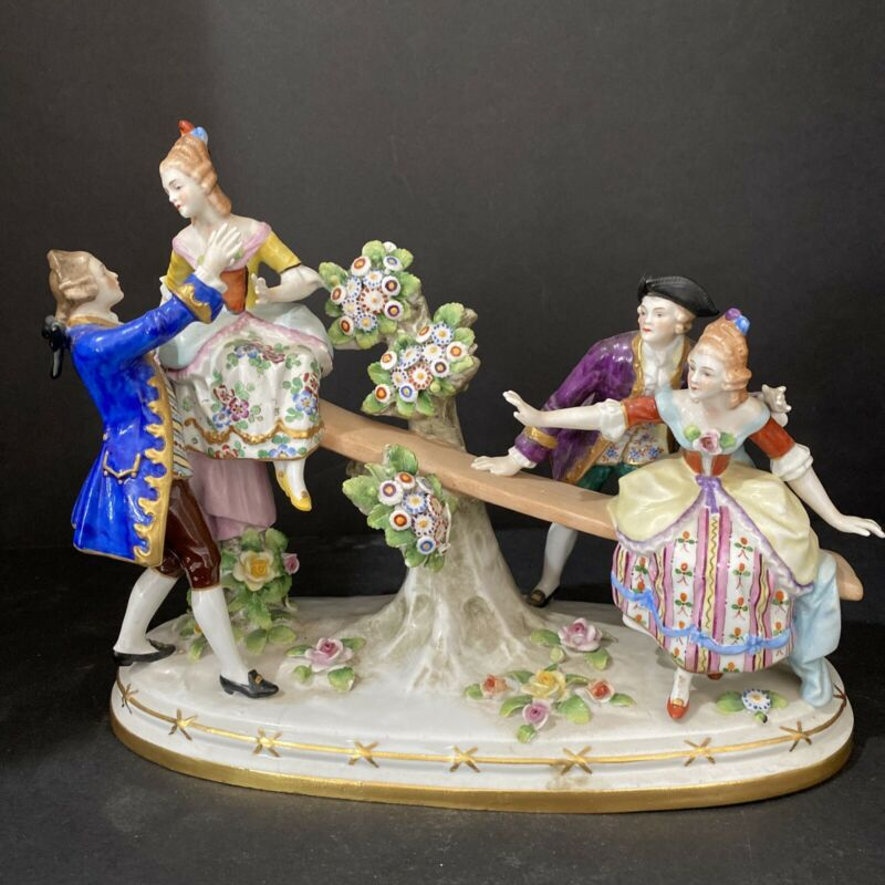 "Porcelain Figurine Of Seesaw with Two Couples 11"" Long 8.5"" tall"