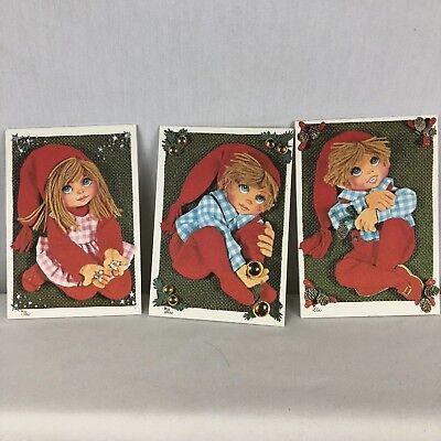8 Vtg Christmas Cards Big Eyes 1973 Carlton Cards Canada Yarn Hair Kitsch Retro
