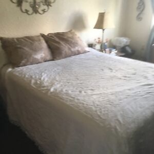 Double ivory bedspread and two taupe beaded pillow shams