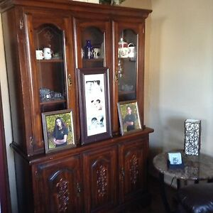China Cabinet and table with four chairs.