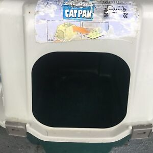 Cat litter box + water bottle