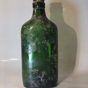 old green whiskey bottle