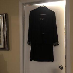 Sleeveless black dress with a matching blazer