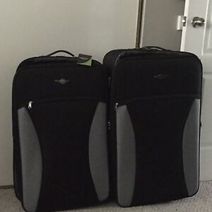 Brand new with tags on luggage