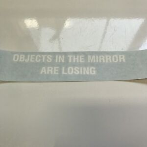 Objects in the mirror are losing sticker