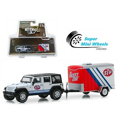 Greenlight Hitch & Tow 2015 Jeep Wrangler Unlimited and STP Trailer 1/64