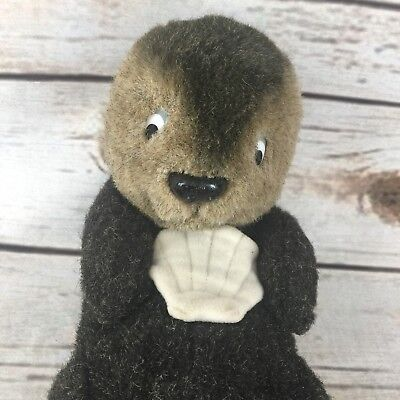 A Stuffed Animal (Sea World Dakin Plush Otter Stuffed Animal 1981 Holding A Seashell Dark)