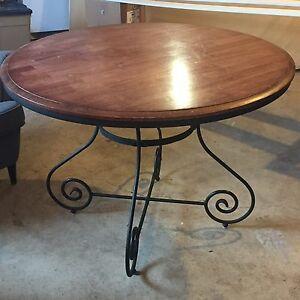Round wood and rod iron table