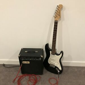 Electric Guitar, Amp, Cord and Strings