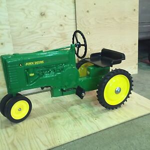 JOHN DEERE TOY CAST IRON RIDING PEDAL TRACTOR