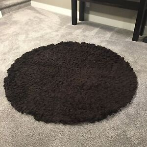 """Round 60"""" (5 ft) brown shag area rug"""