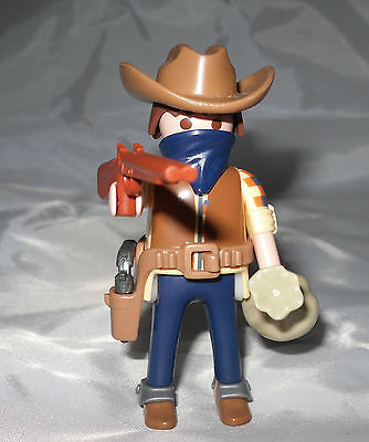 Playmobil / 1 Cowboy mit Gewehr ( Räuber ) / Exclusive Figur / Neu