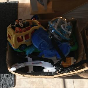 Two boxes of toys, tonka, turtles etc