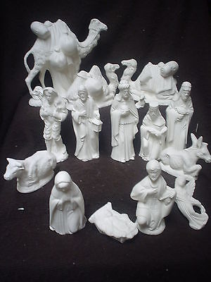 C462 - Ceramic Bisque 16 Piece Doc Holliday nativity - NO stable