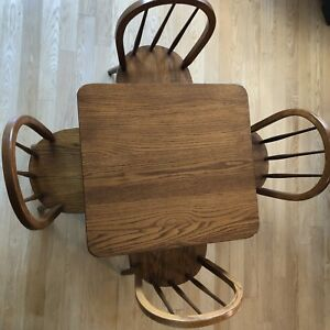 Child's Solid Oak table set with 4 chairs