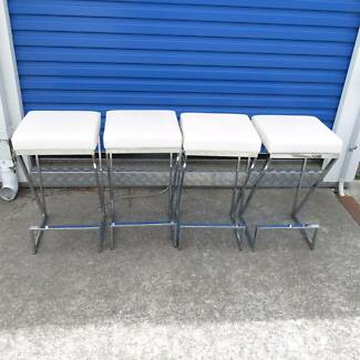 Set of four stylish bar stools