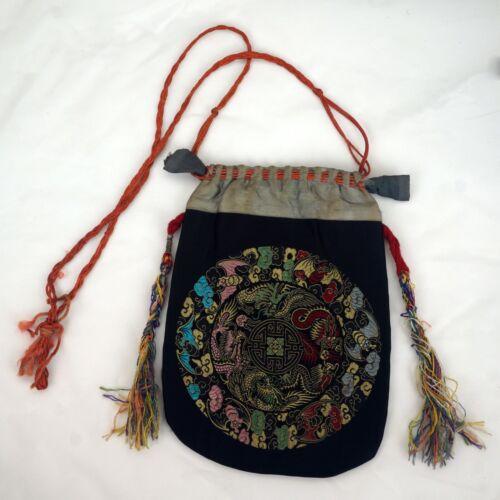 Chinese brocade fabric silk purse with dragon and bat design circa late 19th C